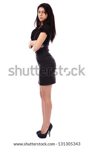 Young Latino businesswoman standing with her arms crossed in full length pose, isolated on white background - stock photo