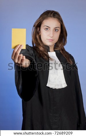 Young law school student showing a yellow card - stock photo