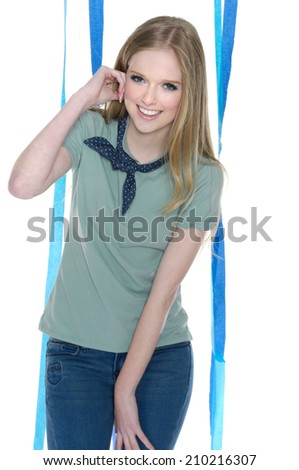 young leisure woman in jeans with blue ribbons posing   - stock photo
