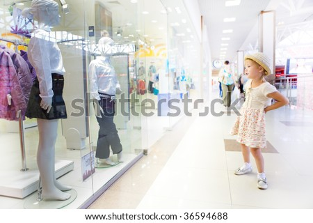 young little girl in shopping mall center - stock photo