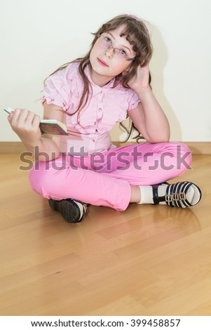 Young little girl reading book - stock photo