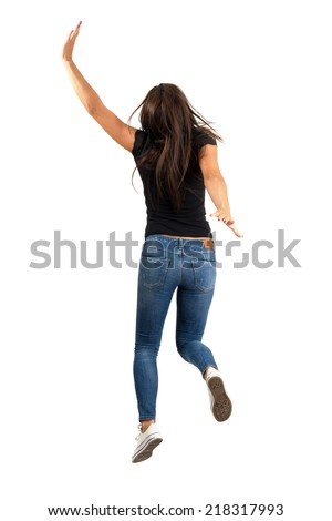 Young long hair woman jumping or running away. Backside view. Full body length isolated over white background. - stock photo