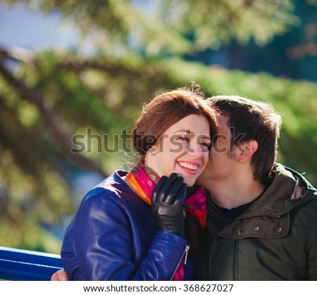 Young love couple resting in spring garden - stock photo