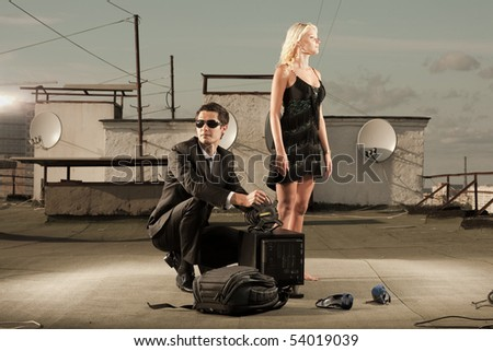 Young love Couple roof under sky - stock photo