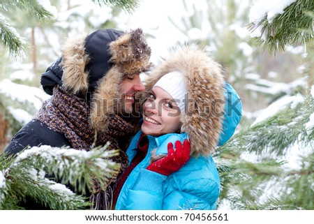 Young love Couple smiling against the winter sky - stock photo