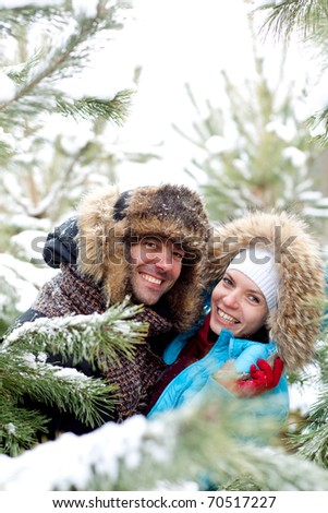 Young love Couple smiling against winter sky - stock photo