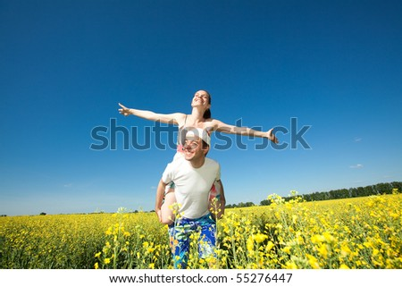 Young love Couple smiling under blue sky - stock photo