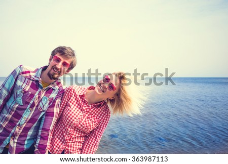 Young loveing couple having fun near lake in spring forest - stock photo