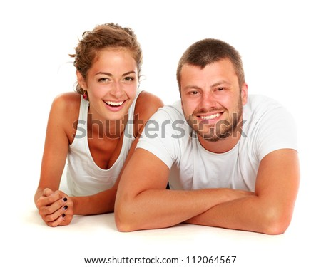 young lovely couple lying - stock photo