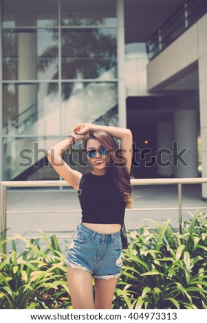 Young lovely girl in denim shorts enjoying her day - stock photo