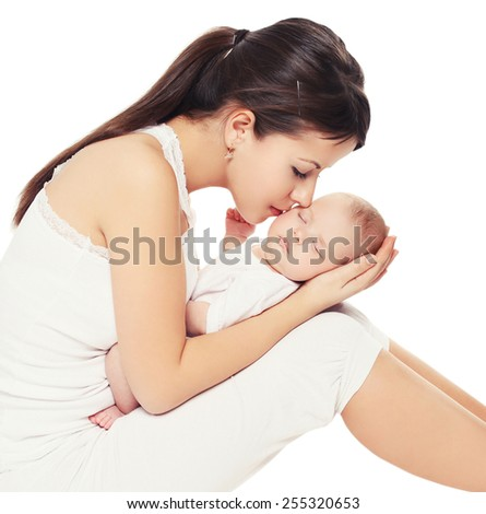 Young lovely mother kissing her baby - stock photo