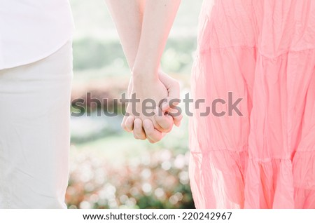 Young lovers couple holding hands. - stock photo