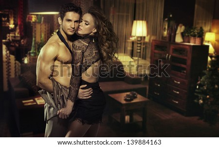 Young lovers in a beautiful home interior - stock photo