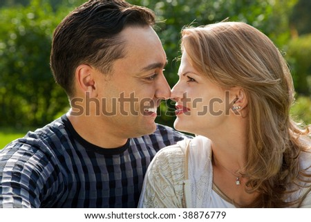 young loving couple face to face outdoors - stock photo