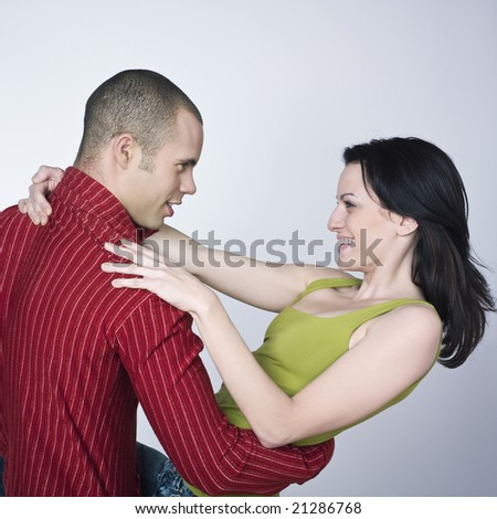young loving couple on isolated background - stock photo