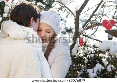 young loving couple on natural background - stock photo