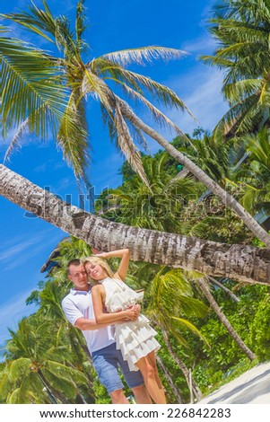 young loving couple on tropical island, outdoor wedding ceremony - stock photo