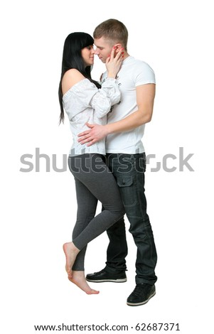 Young loving pair, kiss on the white isolated background - stock photo