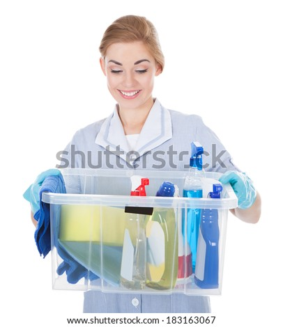 Young Maid Holding Bucket With Cleaning Supplies Over White Background - stock photo