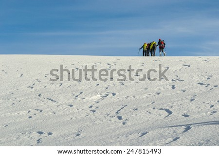 Young making a journey through the snowy mountain - stock photo