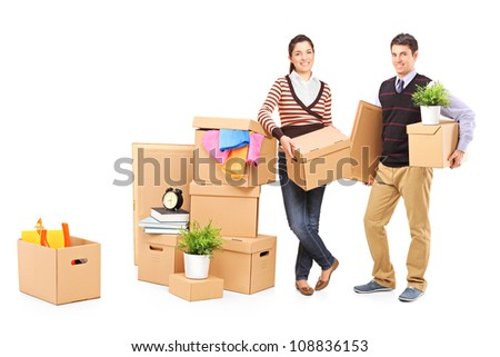 Young male and female packing boxes, preparing for moving, isolated on white background - stock photo