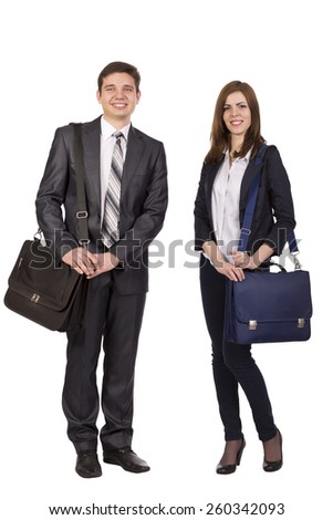 Young male and female students with bags officially dressed on white background. - stock photo