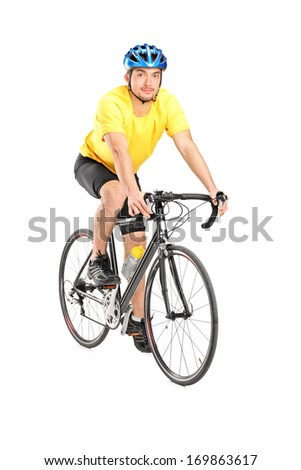 Young male biker looking at camera, isolated on white background - stock photo