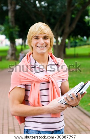 young male college student in campus outdoors - stock photo