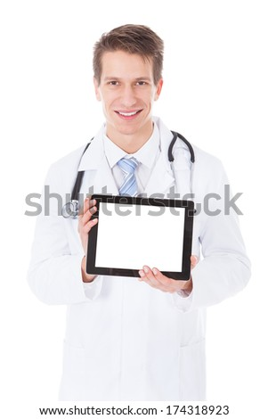 Young Male Doctor Holding Digital Tablet Over White Background - stock photo