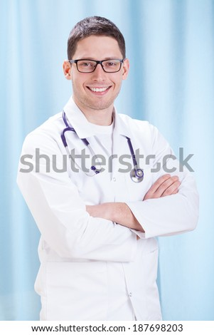 Young male doctor standing in the office  - stock photo