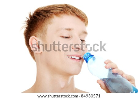 Young male drinking water , isolated on white background - stock photo