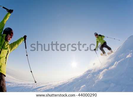 Young male freerider skier moving down in snow powder at sunset; italian alps. double exposure - stock photo