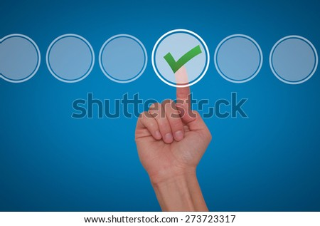 Young male hand touching, pressing modern button and ticking check box out of empty boxes on digital screen interface. Isolated on blue. Business technology concept. Stock Image - stock photo
