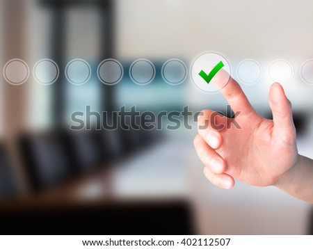 Young male hand touching, pressing modern button and ticking check box out of empty boxes on digital screen interface. Isolated on grey. Business technology concept. Stock Image - stock photo