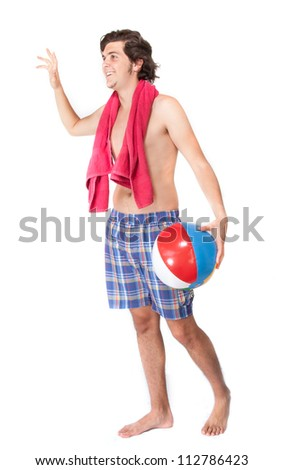 Young male holding towel and beach ball on white background - stock photo