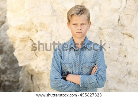 Young male model posing at the camera , wearing a denim shirt and men's watches - stock photo