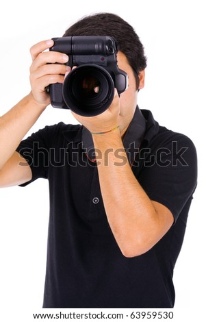 Young male photographer at studio, isolated on white - stock photo
