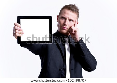 Young male presenting his tablet against a white background - stock photo