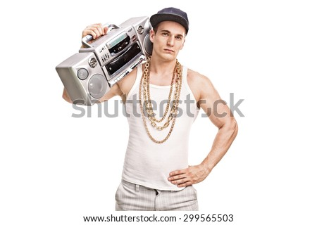 Young male rapper holding a ghetto blaster over his shoulder and looking at the camera isolated on white background - stock photo