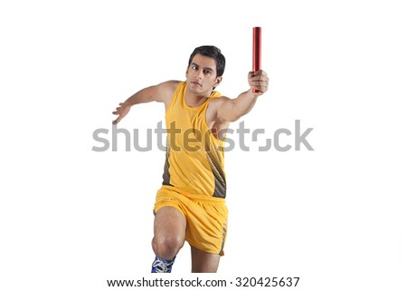Young male relay runner isolated over white background - stock photo