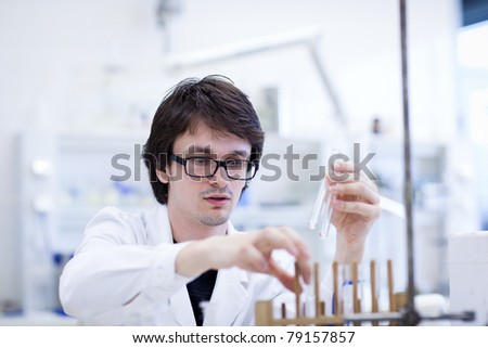 young male researcher carrying out scientific research in a lab (shallow DOF; color toned image)young male researcher carrying out scientific research in a lab (shallow DOF; color toned image) - stock photo