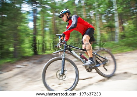 young male riding a mountain bike outdoor - stock photo