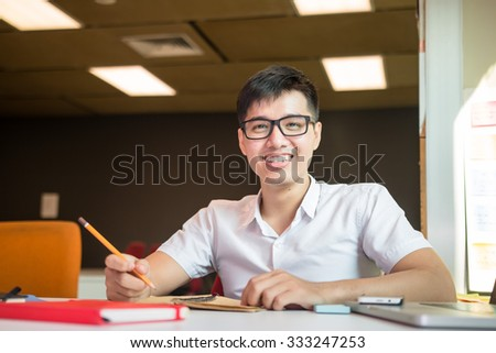 Young male student studies for the examination in university  - stock photo