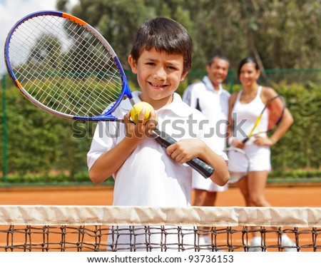 Young male tennis player at a clay court - stock photo