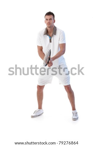Young male tennis player waiting for ball, concentrating.? - stock photo