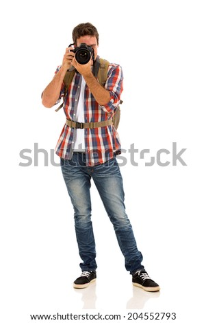 young male tourist taking photos isolated on white - stock photo