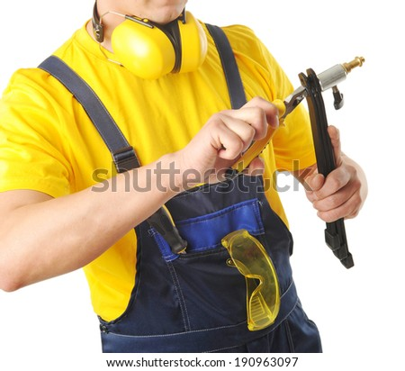 young male worker with instruments isolated on white background - stock photo