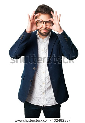 young man adjusting his glasses - stock photo