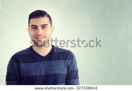 Young man against a grey background portrait - stock photo