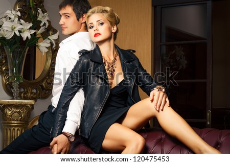 young man and beautiful young woman in beautiful interior. Fashion shoot. - stock photo